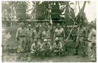 Sergeant Francis Bagley (standing, 5th from left) at Aitape, PNG, May 1944.  Note the 55-gallon drums rigged on a frame for cold water shower-use.