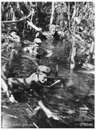 An Australian patrol in deep swampland near the Hupai River in January 1945. Such movements in harsh terrain close to concealed Japanese positions were a feature of the Allied advance towards the main Japanese concentration at Buin, in the south of the island.