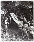 Japanese troops manhandling a Type 41 75mm infantry gun through the jungle, Malaya, 22 January 1942.  The Japanese Army had spent most of the previous decade preparing to fight the Soviets in Manchuria while waging a real war against the rest of China: it was woefully ill-equipped for tropical warfare.  Nevertheless, the stoic endurance, discipline and determination of its soldiers saw the Japanese Army overwhelm the equally ill-prepared British and American forces arrayed against it in the first months of 1942.