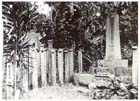 A Japanese memorial to the dead located near the former Japanese naval headquarters at Buin on the island of Bougainville, September 1945.  A memorial stone (right) is surrounded by wooden grave markers commemorating the names of individual soldiers and sailors.  It is unlikely that any remains or ashes were actually buried here as the Japanese, who traditionally cremated their dead, usually sent the ashes of the fallen back to their families in Japan or stored them until such time as it was possible to do so.
